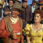 L. to R. : Jack Kruschen, John Wayne, Maureen O'Hara & Chill Wills in McLintock! (cropped screenshot) 1963  (Batjac-Paramount Pictures)